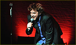 Dylan Moran performed in English, with a Russian translation provided via headphones,in SPb