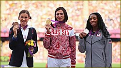 Medallists pose during the 400m Hurdles Victory Ceremony